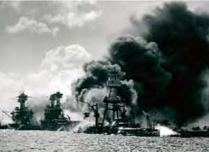 Battleships under attack at Pearl Harbor.