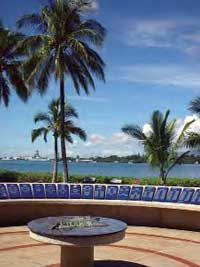 Pearl Harbor Tour includes the USS Arizona Memorial located offshore.