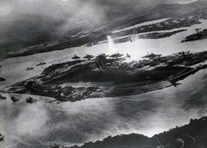 The first bomb drops at Pearl Harbor.